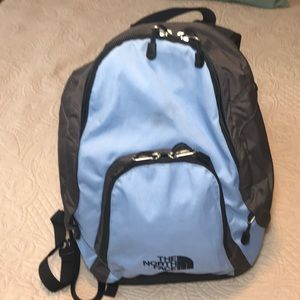 The North Face blue and gray used backpack